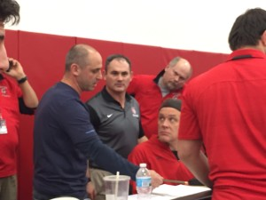 Officials review team scoring at the conclusion of the tournament